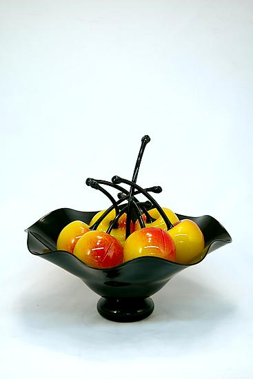 Black Fluted Bowl of Rainier Cherries - Art Glass Sculpture - by Donald Carlson