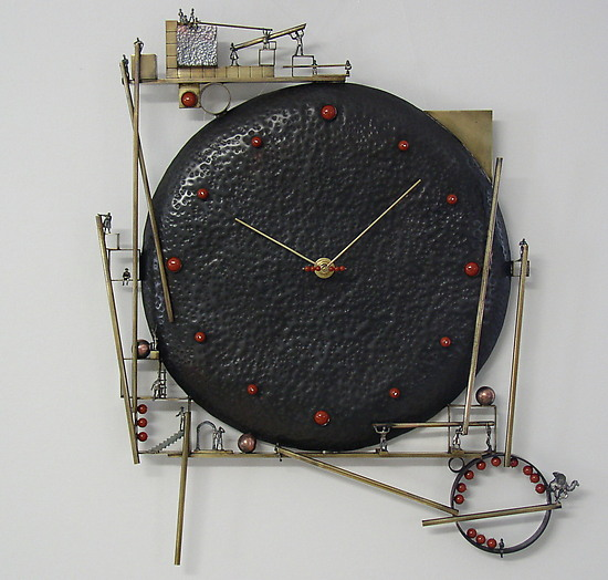 Future Clock - Metal Clock - by Malcolm Owen and Mary Ann Owen