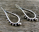 Silver Earrings by Delias Thompson